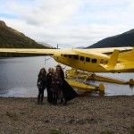 Our plane, and from left to right, Eric, the boatman, all my girls and Granny, and walking off, Scott the pilot...